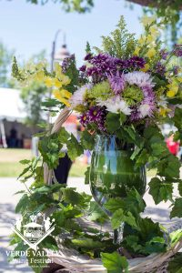 Flower arrangement in wine glass